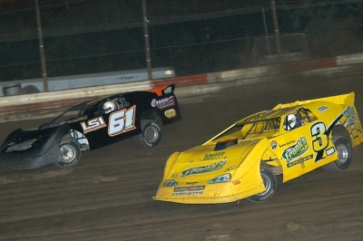 George Lee (61) rides the high side to victory at Hilltop Speedway. (Diane Bemiller)