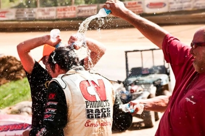Chris Ferguson is doused with water in victory lane. (peepingdragonphotography.com)