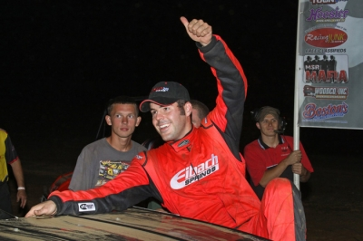 Billy Moyer Jr. emerges from his car after his Comp Cams victory in Harrisburg, Ark. (Woody Hampton)