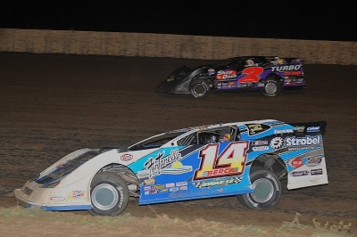Kyle Berck (14) takes the second spot from John Anderson (2). (fasttrackphotos.net)