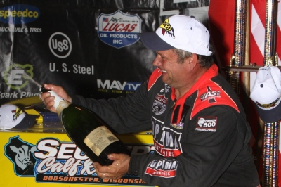 Champagne-spraying Don O'Neal celebrates. (Jeremey Rhoades)