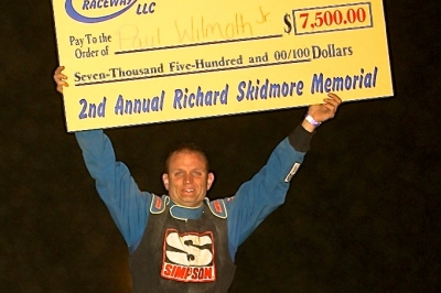 Paul Wilmoth Jr. shows off the $7,500 winner's paycheck. (Tommy Michaels)