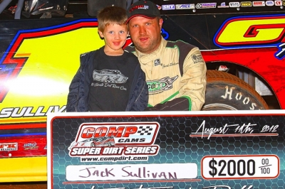 Jack Sullivan celebrates with son Jace after his Comp Cams Series victory. (Woody Hampton)
