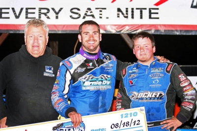 Josh Richards (center) embraces runner-up and teammate Brandon Sheppard in victory lane. (Steve Datema)