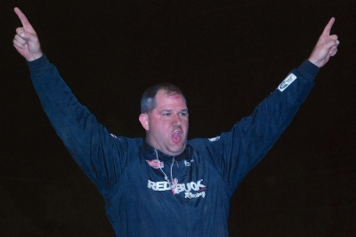 Dustin Neat climbed atop his car to celebrate his $7,500 victory. (DirtonDirt.com)