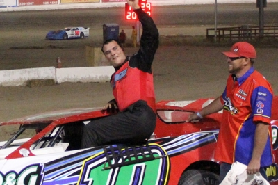 John Hansen emerges after his victory at Aztec Speedway. (www.facebook.com/Crimson.n.cream.photo)