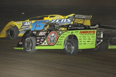 Brian Birkhofer (15B) fends off Scott Bloomquist. (Jeremey Rhoades)