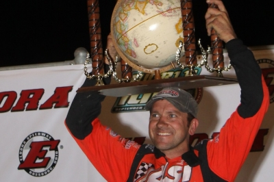 Brian Birkhofer shows off his second globe trophy. (Jeremey Rhoades)