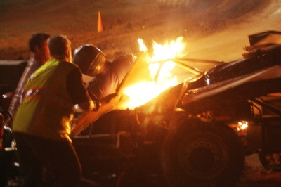 Safety workers help Michael Smith out of his burning car in Lawndale, N.C. (ZSK Photography)