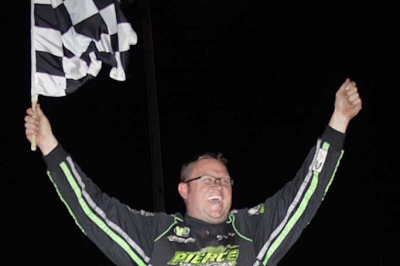 Jason Feger celebrates his $10,000 victory. (Jim DenHamer)