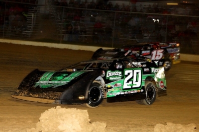 Jimmy Owens (20) repels a rare challenge from Steve Francis (15) at the Jackson 100. (Roy D. Walker)