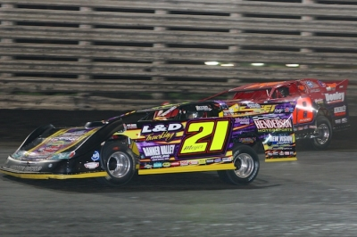Billy Moyer (21) takes the lead from Shannon Babb on the eighth lap. (Barry Johnson)