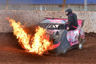 James Plemmons climbs from a fiery crash; he wasn't hurt. (Gary Laster)