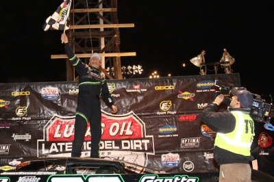Jimmy Owens climbs atop his car celebrating his $50,000 victory. (rdwphotos.smugmug.com)