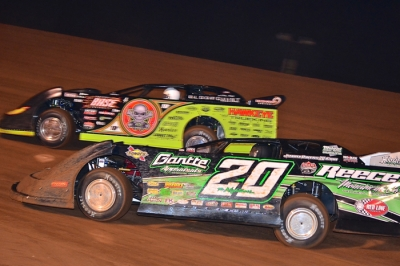 Jimmy Owens (20) and Scott Bloomquist (0) battle at East Alabama. (Eric Gano)