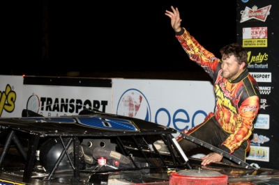 Kyle Beard climbs from his car. (Ron Mitchell)