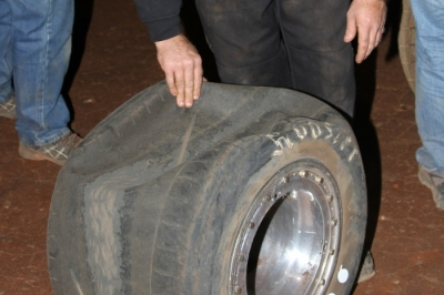A crew member looks at Marlar's tire after the race. (Clifford Dove)