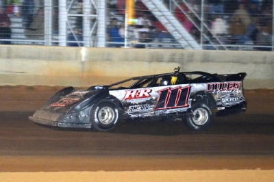 Stacey Roberts raises an arm as he takes the checkers at Needmore. (Troy Bregy)
