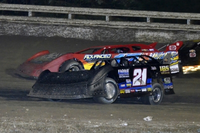Winner Ivedent Lloyd Jr. (21) makes a low-side move. (Troy Bregy)