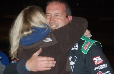 Shane Clanton gets a hug from wife Michelle after winning at Screven. (DirtonDirt.com)
