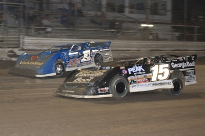 Josh Richards (1) takes the lead from Steve Francis (15) in Monday's Volusia opener. (stlracingphotos.com)