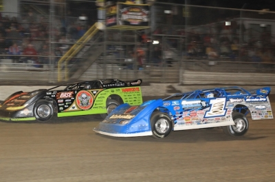 Winner Josh Richards (1) goes by Scott Bloomquist (0) early in the main event. (stlracingphotos.com)