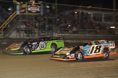 Scott Bloomquist (0) takes the lead from Eric Wells (18) on lap 37. (stlracingphotos.com)
