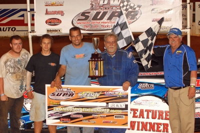Robbie Starnes and his team enjoy victory lane at Lone Star. (Alton Cotton)