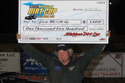 Rich Neiser shows off his big check at I-96 Speedway. (Jim DenHamer)