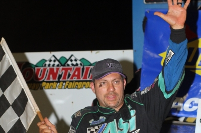 Chris Madden waves in victory lane. (Chad Wells)