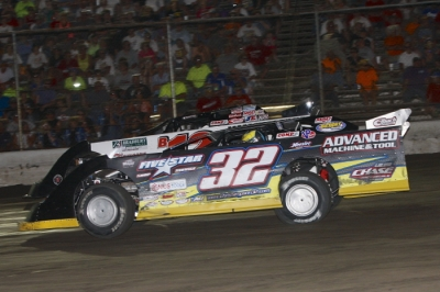 Chris Simpson (32) heads for his first Summernationals victory. (Jim DenHamer)