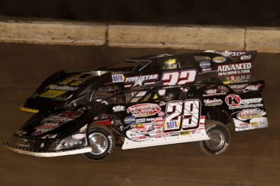 Darrell Lanigan (29) takes the lead from Chris Simpson (32) on the 10th lap. (Scott Swenson)