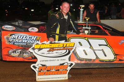 Rodney Walls enjoys victory lane at Winchester. (Travis Trussell)