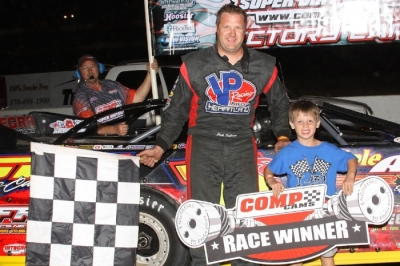 Jack Sullivan is joined in victory lane by his son Jace. (Woody Hampton)