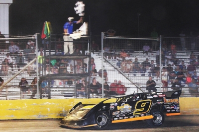 Shane Hebert takes the checkers at Golden Triangle Raceway. (ronskinnerphotos.com)