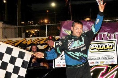 Chris Madden waves in victory lane. (Howard Lawson)