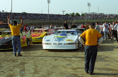 Earl Baltes looks over cars in the infield. (rickschwalliephotos.com)