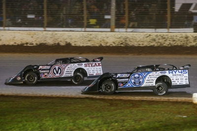 Chris Madden (0M) leads teammate Scott Bloomquist (0). (Brent Smith)