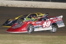 Jonathan Davenport (49) passes Billy Moyer (21) on his way to a win in the first heat Friday. (Zach Yost)