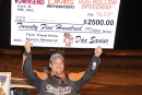 Dan Angelicchio shows off his paycheck after his Sept. 22 victory in the Thunderdog weekend opener at Dog Hollow Speedway in Strongstown, Pa. (Howie Balis)