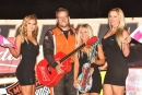 Nick Bartels holds a guitar and poses with three California girls after winning the Oct. 14 Budweiser Nationals finale at Bakersfield (Calif.) Speedway. (photofinishphotos.com)