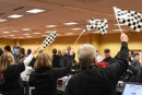 At Performance Racing Industry Trade Show registration, those checking folks in wave checkered flags to let them know to come forward Dec. 8 at the Indiana Convention Center. (DirtonDirt.com)