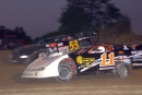 Brian Ruhlman (11) and Hillard Miller pace the ALMS field on the opening lap at Indiana's Gas City I-69 Speedway on May 19, 2006. (DirtonDirt.com)