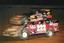 Mike Boland (222) battles Anthony Rushing (70 1/2) en route to victory in the 2004 Fall Classic at Queen City Speedway on Meridian, Miss. (Wayne Williams)