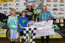Jimmy Owens poses in victory lane with his son, Nathan, and Show-Me 100 founders Don and Billie Gibson after winning the couple's May 25 tribute race at Lucas Oil Speedway in Wheatland, Mo. (heathlawsonphotos.com)