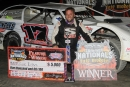 Zack Dohm picks up his paycheck July 13 at Oakshade Raceway in Wauseon, Ohio, for his first career DIRTcar Summer Nationals victory. (Jim DenHamer)