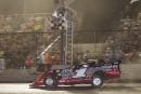 Earl Pearson Jr. takes the checkered flag at Tri-City Speedway to complete Frriday's victory in the NAPA Know How 50. (heathlawsonphotos.com)