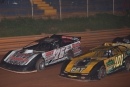 Brandon Overton (76) and Casey Roberts (101) lead the field to green to start Thursday's Schaeffer's Southern Nationals race at Toccoa Raceway. (Brian McLeod)