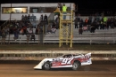 Cade Dillard flashes under the flagstand at Chatham Speedway to complete a $2,000 victory in Friday's Spooky 30. (Best Photography)