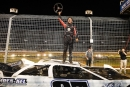 Corey Gordon climbed atop his car to celebrate May 24's FUEL victory at The Dirt Track at Charlotte in Concord, N.C. (Barry Cantrell)